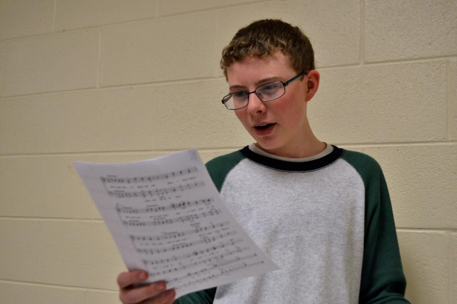 Freshman+Joseph+Jenkins+demonstrates+his+singing+capabilities.+Together+with+Jenkins%2C+NC%E2%80%99s+own+Joshua+Dixon+and+Chandler+Quaile+all+made+the+grade+for+the+statewide+ensemble.+%E2%80%9CIt%E2%80%99s+a+really+fun+experience%2C%E2%80%9D+Jenkins+said.