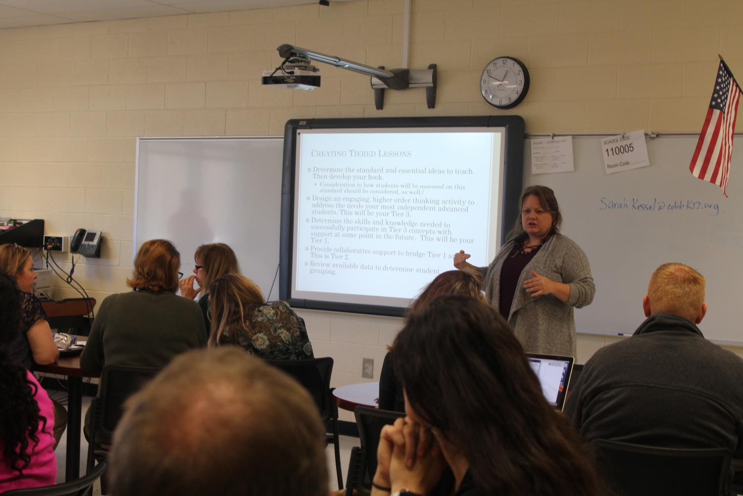 """Today, teachers attended a presentation by Cobb County employee Sarah Kessel and ninth grade literature teacher, Laura Smith. """"The meeting was about different ways to teach advanced students who may already understand the material better than others. Kessel and Smith gave examples of different methods to help these students learn, without wasting time on knowledge they already acquired,"""" said math teacher, Brenda Slater."""