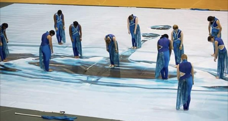 """The varsity winter guard opened their show, titled """"Go with the Flow"""" and received second place for their stellar performance."""