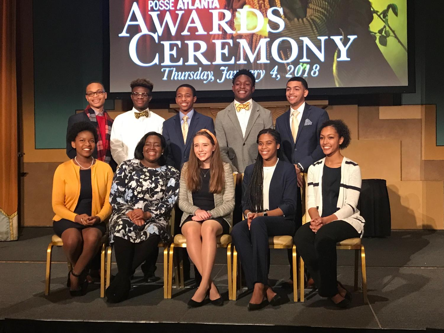 """Senior Jayden Bourne (pictured in top row on the right) takes pictures with his fellow Posse Scholars at the acceptance reception ceremony. """"Being able to attend this reception was a dream come true knowing that I finally achieved what I set my sights on at the beginning of the year,"""" Bourne said."""