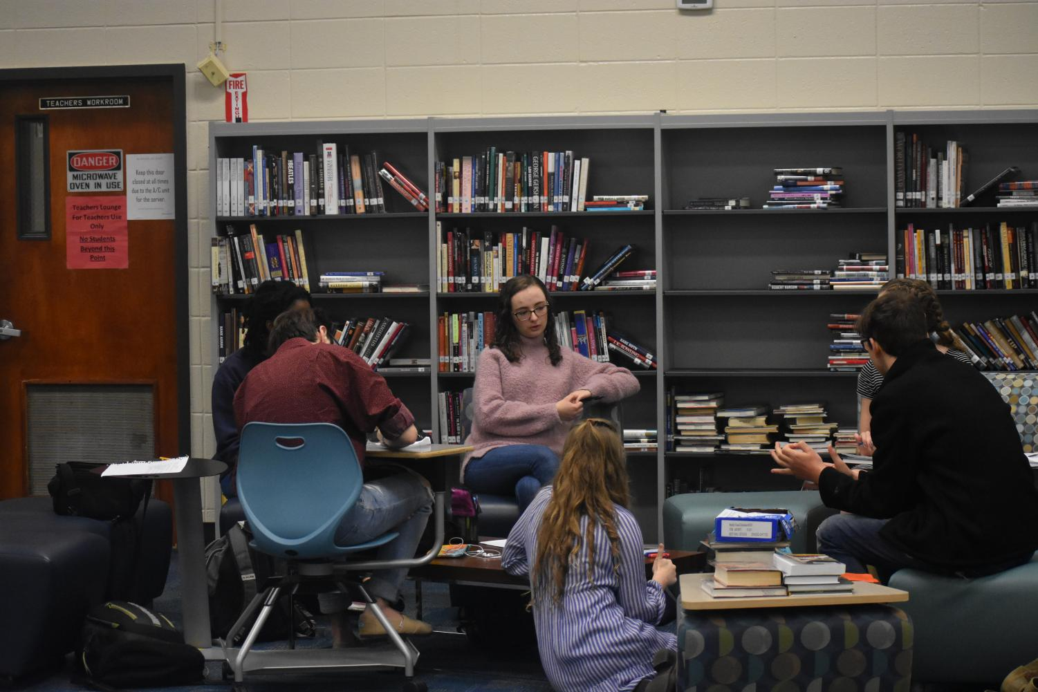 The Model United Nations team spends their Wednesday morning in the library, perfecting their argumentative and diplomatic craft.