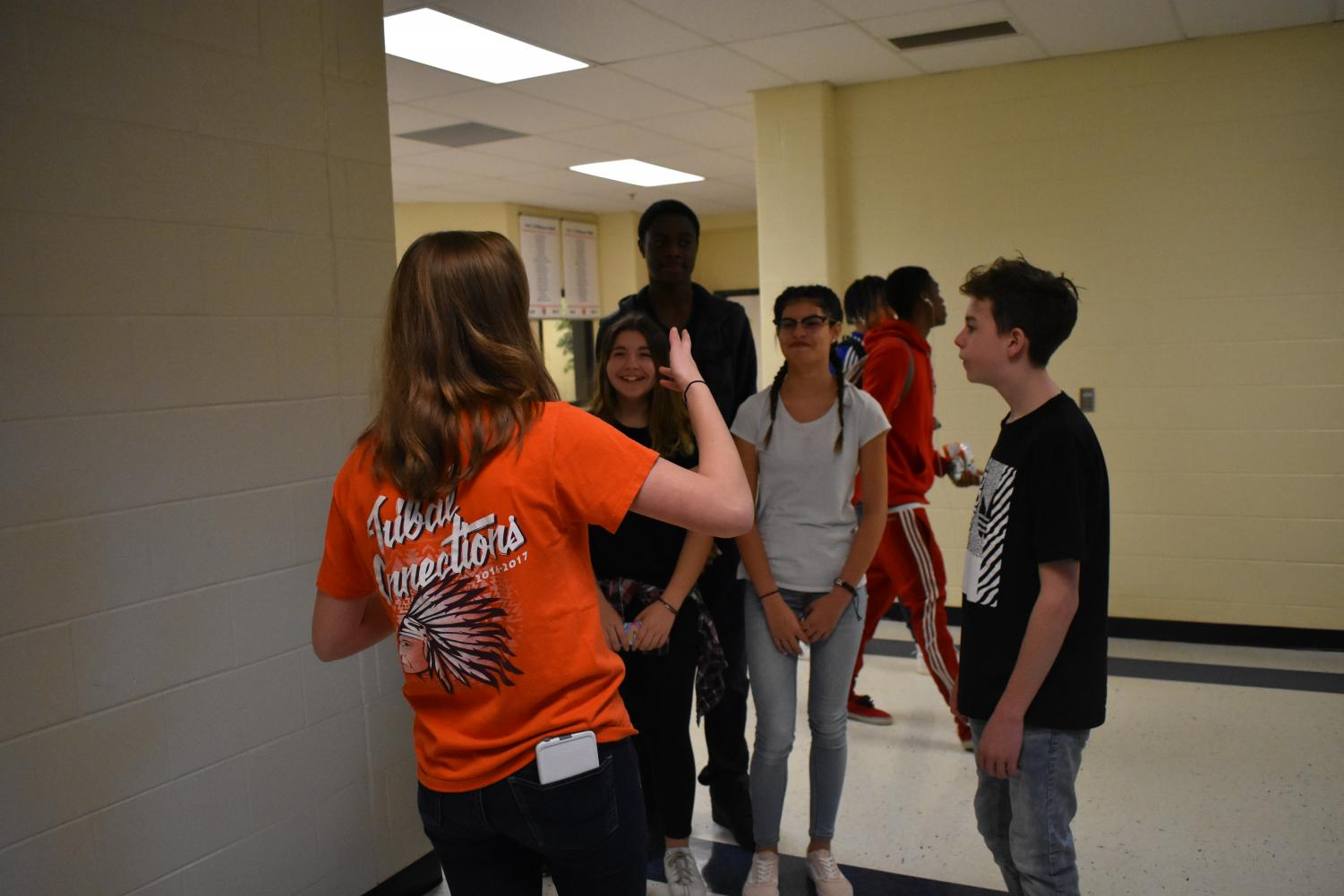 "Sophomore Gabby Gilchrist tours Palmer students around The Freshman Academy. Students show engagement and interest and ask questions about their future school's environment. ""The kids were super fun to tour around the school,"" Gilchrist said."