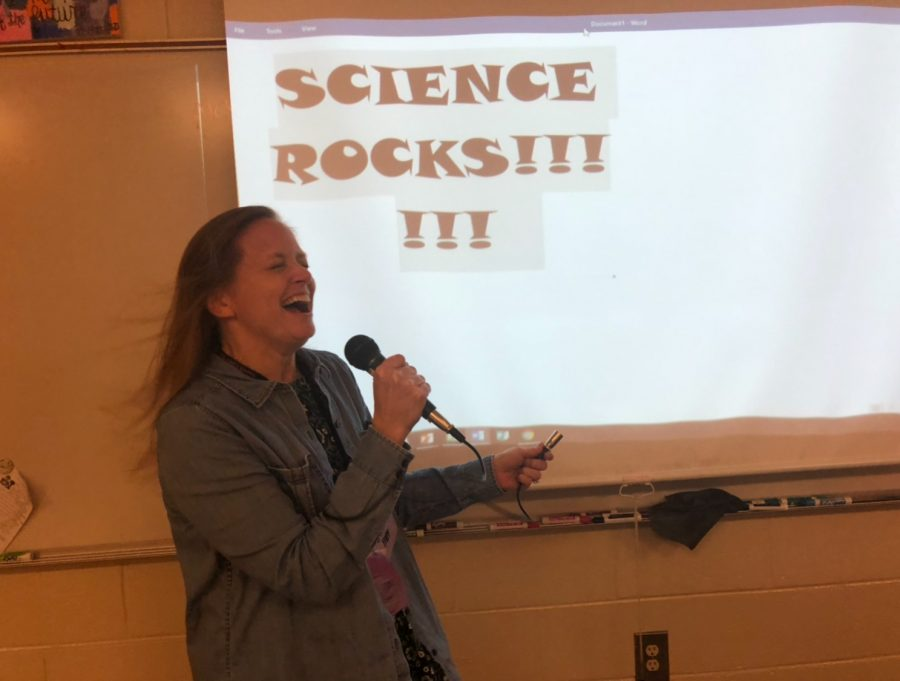 Methods+and+Madness+lead+singer+Julie+Hopp+screeches+out+their+hit+song+%E2%80%9CI+am+a+Bird+Nerd%E2%80%9D+for+her+classroom%2C+promising+a+day+of+interesting+education.+Taking+inspiration+from+90s+hair+bands%2C+Hopp+adds+in+head+banging+and+enthusiasm.+%E2%80%9CI%E2%80%99ve+got+to+channel+my+inner+Madonna+before+I+perform%2C%E2%80%9D+Hopp+said.++%0A