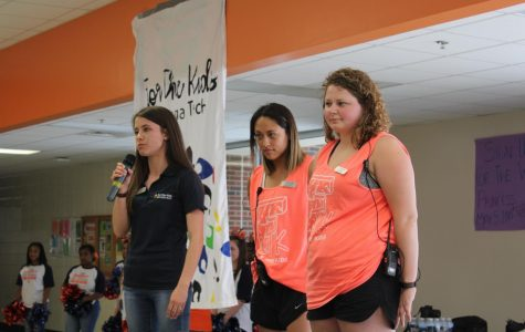 Amber Fleeman, Georgia Tech's FTK executive director, joined by the event chairs Alana Agcaoili and Breanna Mann stand on stage speaking and kicking of the eventful day.