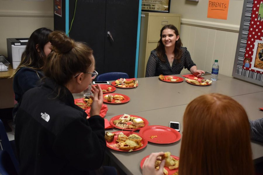 Students in the club converse and laugh while chowing down on the variety of food on their plates. A number of students revisited the food table for seconds, and even thirds, of their favorite dishes.