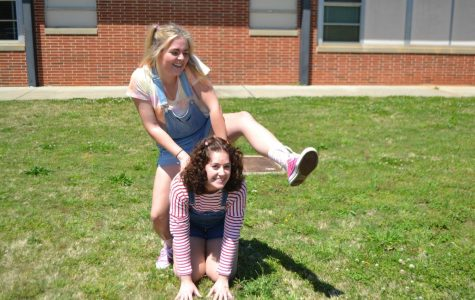 Students jump into Kindergarten day as they start the senior dress up week. Seniors Chelsea Scarborough and Maddy Bilbrey dress up with sandals, high socks, and pigtails. The two school children play leap frog during lunch in the courtyard. Students will lay out their outfits for tomorrow's theme of purple out, in memory of the student Arielle Sterrett.