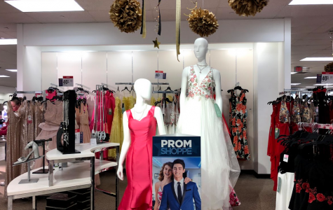 """Racks burst with an abundance of dresses of all colors and sizes at stores in preparation for prom. JCPenney readies its """"Prom Shoppe,"""" displaying prom dresses alongside jewelry and fancy decorations."""