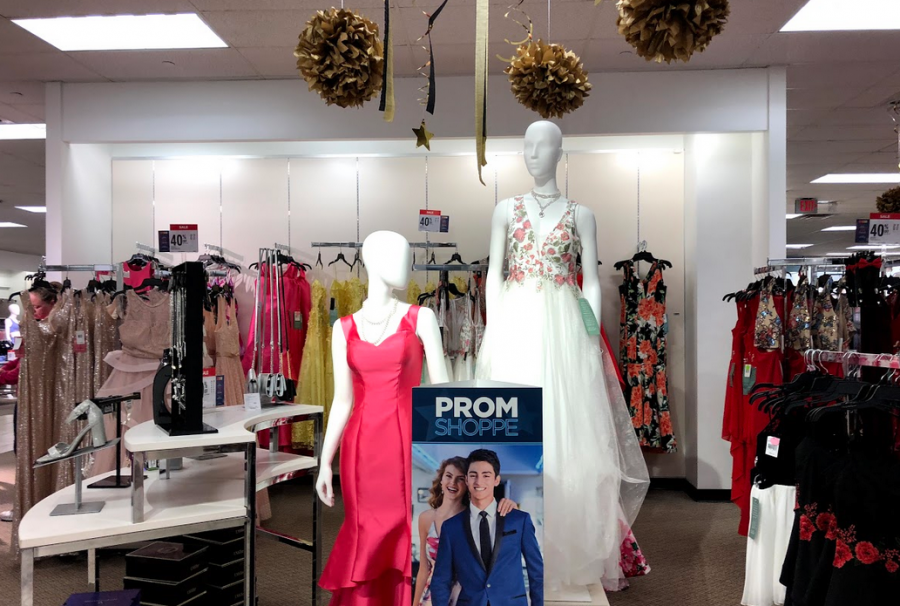 "Racks burst with an abundance of dresses of all colors and sizes at stores in preparation for prom. JCPenney readies its ""Prom Shoppe,"" displaying prom dresses alongside jewelry and fancy decorations."