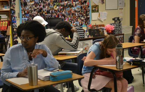 """Ms. Rankenburg's 3rd period class is hard at work on one of their final assignments for AP US History: writing a song. """"We're taking a song and putting our own lyrics over it about American History. Everyone has a theme; my theme is wars, so our song is about all of the wars,"""" junior Tess Thompson said. In addition to writing their songs, the students will make videos to go with them. """"It's a lot of fun,"""" Thompson said."""