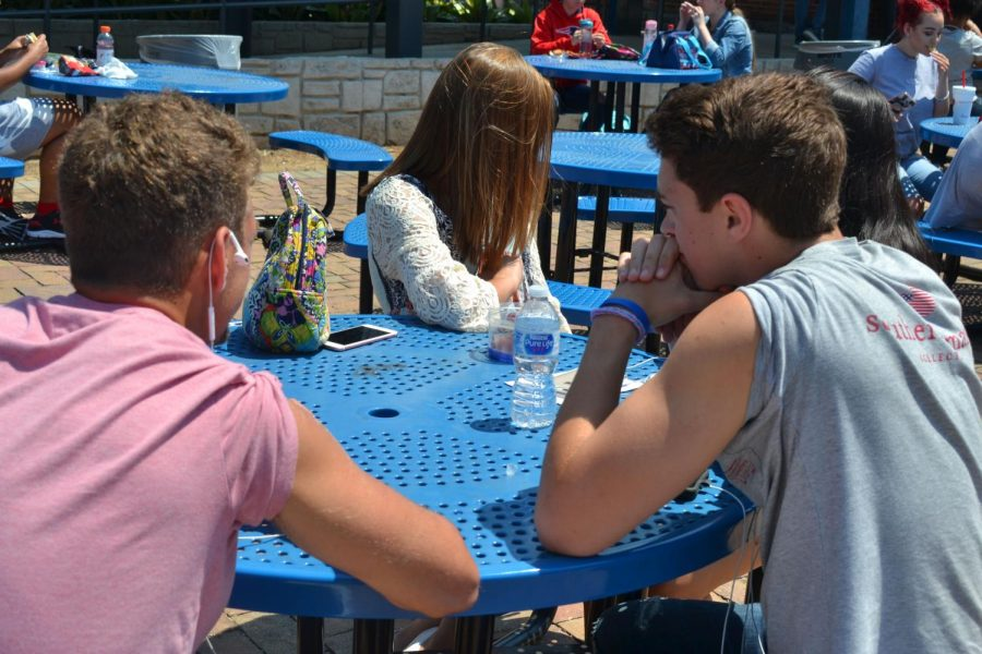While students sit outside during their lunch period, they roll up their sleeves in attempt to keep themselves cool in the sun. The temperature reached an astonishing 88 degrees outside and the week's forecast says nothing but rain will come after this past sunny weekend.
