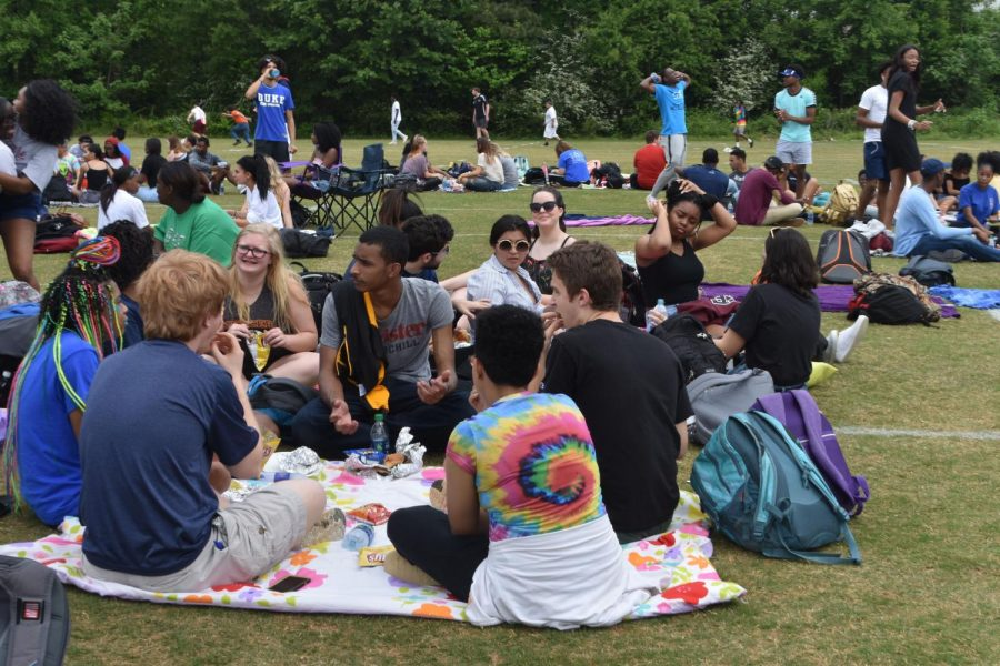 NC Seniors gather around with friends and enjoy their free period out in the sun. After four years of high school, they finally celebrate hard work paying off.