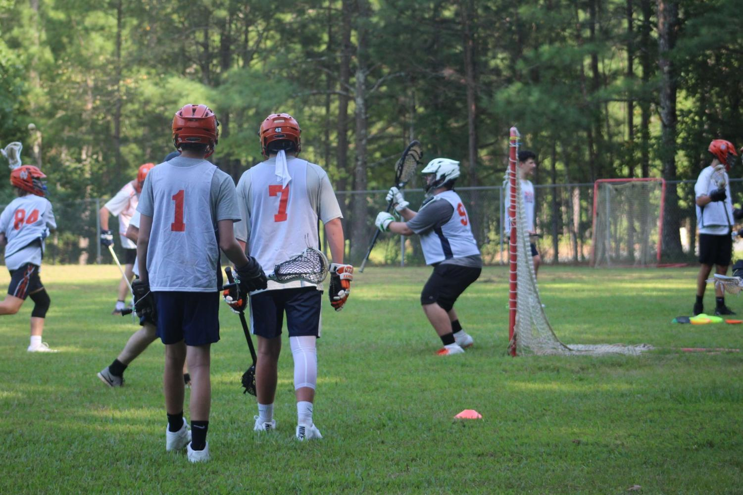 NC boys lacrosse will work on more ball movement drills at their next practice on Thursday, August 23. The players will split between varsity and junior varsity to practice more efficiently and focus on different skills for each group with varsity traveling to the NC upper grass field and junior varsity staying on their usual practice field—the Awtrey middle school field.
