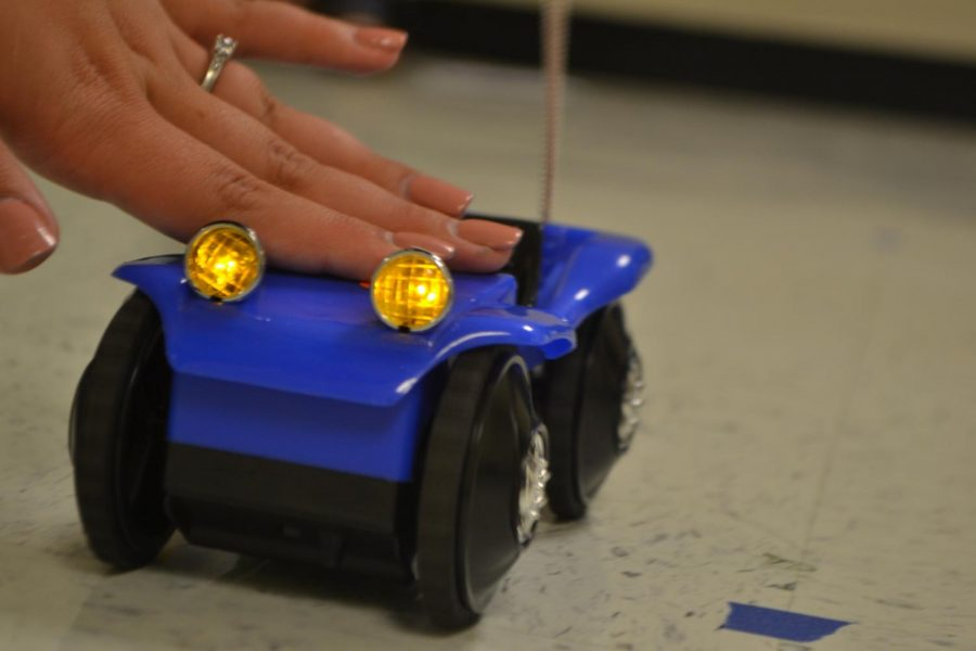 Seniors Claire Vance and Claire Phillips measured a toy car's speed and velocity for Ms. Brennan's Physics class. Physics students complete a wide range of projects throughout the year, but this project stands as a class favorite.