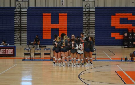 As the Lady Warriors prepare for their next set, they huddle around one last time to work out strategies. The team, desperate to pull out a win, comes to regain their composure.