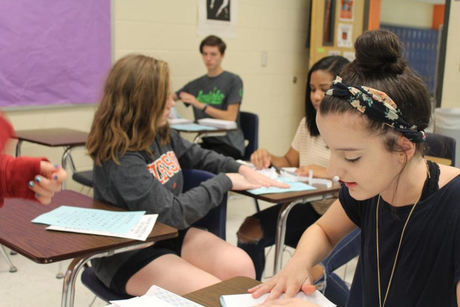 "The yearbook students place stamps on envelopes as they get ready to ship out letters about yearbook senior tributes. The senior tribute constitutes a section in the yearbook dedicated to the students by their parents. ""I'm super excited to see all the tributes we will receive,"" sophomore Taylor Seymour said."