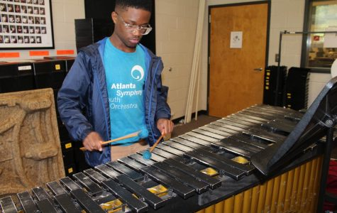 Junior, Kobe Lester plays the marimba, one of at least nine instruments that he plays in the percussion section. As he participates in the Atlanta Symphony's Talent Development Program he hopes to improve his skills as well as helping inspire others in the program.