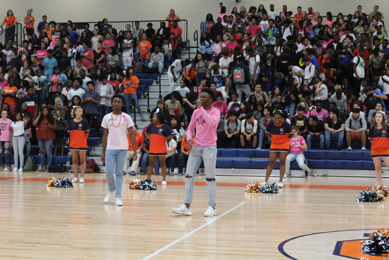 TC senior co-leaders Chike Azusu and Zion Fitch build up student excitement during a pep rally in the Arena. This ability to bring school pride out of all NC students falls high on the requirements for members.