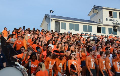 The student section exploded in a sea of orange for the first football scrimmage of the year. Students brought their school spirit and cheered on the Warriors as they played against the Harrison Hoyas.