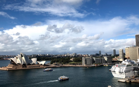 """Overlooking the Sydney Harbor from the famed Sydney Harbor bridge, the group enjoyed the ships passing by and the view of the Opera House and downtown area. After a half-day hike around the city and across the bridge, the group huddled to view the city from the center of the 3,700 footbridge. """"It was interesting to see the Opera house and bridge and all the parks but Australia felt like a normal big city. It wasn't very different than one you'd see in the United States,"""" Magnet senior Steven Tran said."""