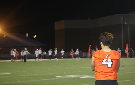 Senior Anthony Rodriguez watched from the sidelines as his team dominated Woodstock, 35-21. Rodriguez trained extremely hard for the position as a kicker on NC's varsity football team. As a result, the Air Force Academy offered Rodriguez a spot on their team and a full scholarship for his dedication.