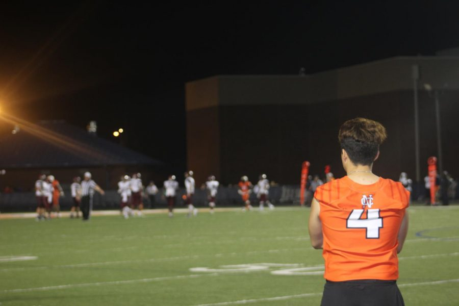 Senior+Anthony+Rodriguez+watched+from+the+sidelines+as+his+team+dominated+Woodstock%2C+35-21.+Rodriguez+trained+extremely+hard+for+the+position+as+a+kicker+on+NC%E2%80%99s+varsity+football+team.+As+a+result%2C+the+Air+Force+Academy+offered+Rodriguez+a+spot+on+their+team+and+a+full+scholarship+for+his+dedication.