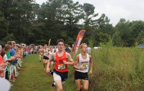 Junior Ryan Getz battles against Brookwood runner to see who will finish the two mile first. Getz gives the two mile his all and exemplifies determination as he is trying to improve his time from previous seasons.