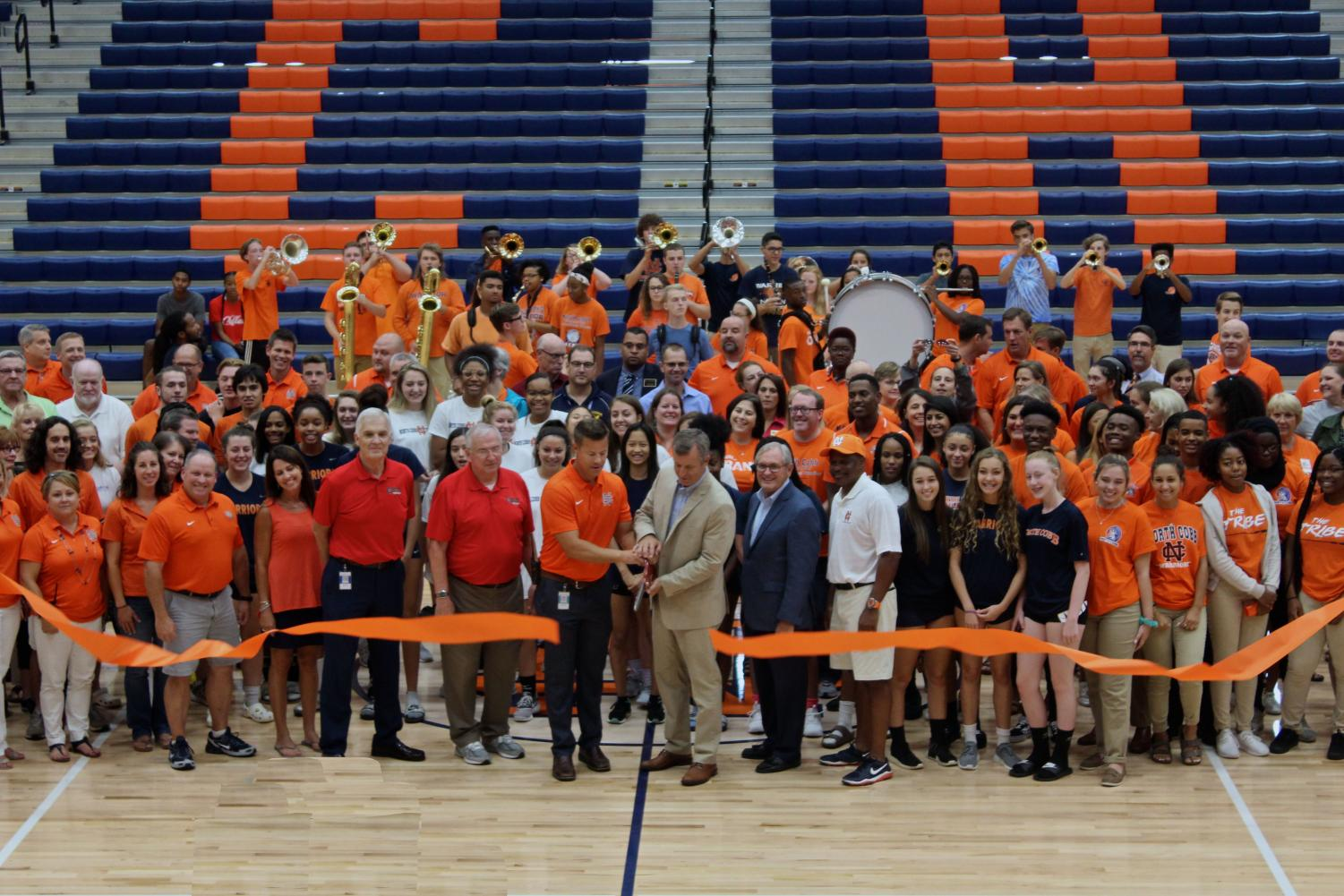 Principal Matthew Moody and Assistant Principal and Athletic Director Matthew Williams celebrated the opening of the new Arena and Performing Arts Center with the historic ribbon cutting ceremony on Tuesday, July 31. The administrative staff, faculty, and student body thanked the EverGreen construction team and the community leaders by providing refreshments and cake after the ceremony.