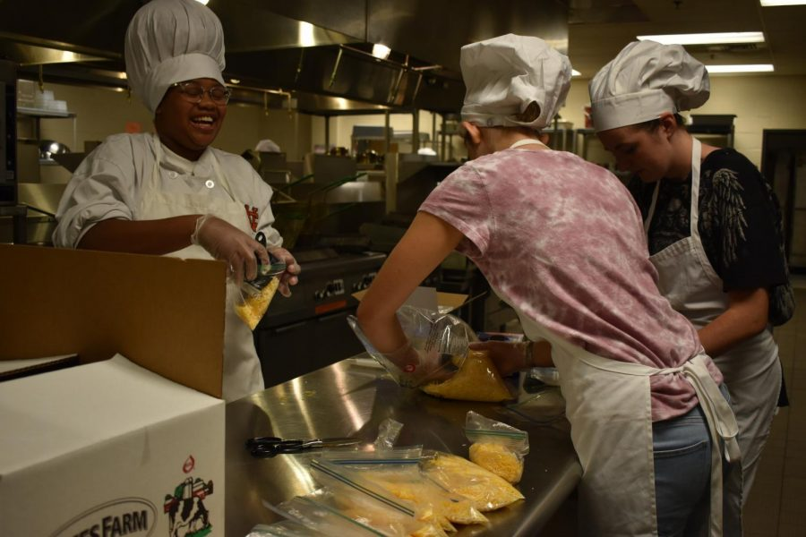 "FCCLA members meet in the culinary room Monday afternoons, improving their culinary schools and creating new relationships. Students appear thrilled as they prepare components of the enchilada meal. ""Everyone in FCCLA is super nice,"" sophomore Kiara Kisor said."