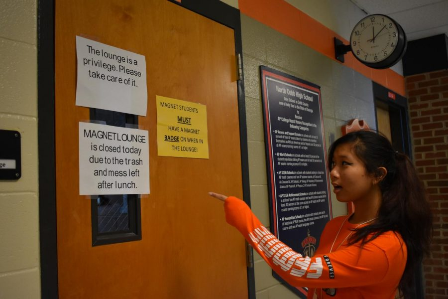 "Students look mournfully upon the Magnet lounge door as it renders closed today due to the unremarkable mess left by students on Monday. ""I'm mad, I eat lunch there everyday,"" junior Grace Nthale said. When it reopens, hopefully certain Magnet students will stay considerate of their trash and mess produced during lunch."