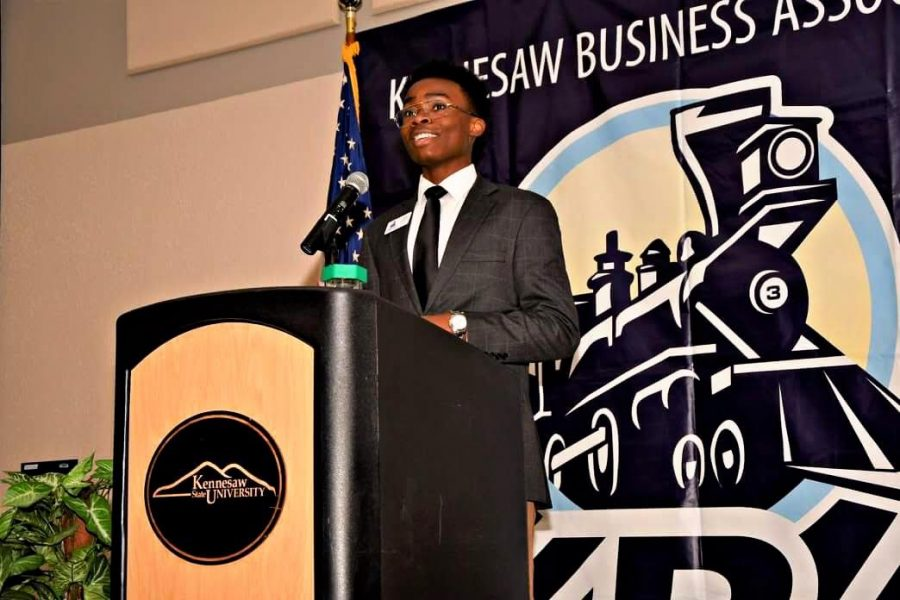 Asuzu takes the chance given to him by TC to speak at the Kennesaw Business Association meeting hosted at Kennesaw State University. Representing NC with a bright and happy smile, Asuzu begins his speech.