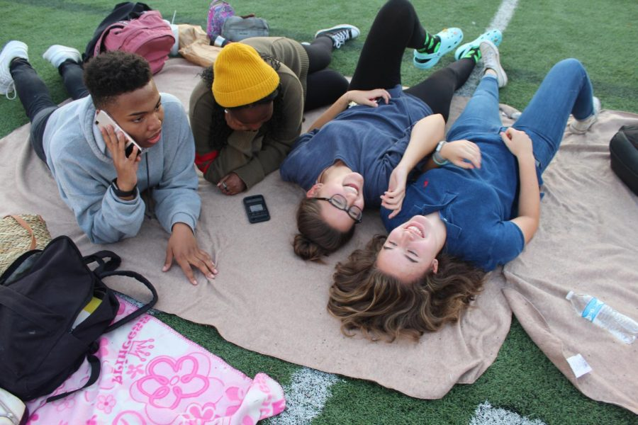 Students arrived early in the evening to claim their spots on the field for Screen on the Green. The lighting from the setting sun drew audience members to capture the perfect pictures, while others just kicked back and relaxed as the night approached.