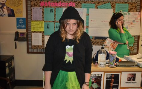 Today marked the second dress-up day of Homecoming week: Meme Fay. Students and teachers filled the halls dressed as today's most popular memes. AP Lang and Honors American Lit teacher Lindsay Theaker dressed up as Dark Kermit from the movie Muppets Most Wanted.