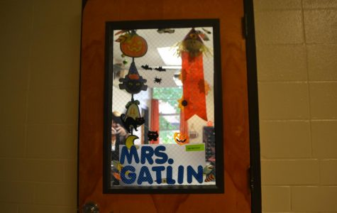 "As the spirit of thrills and chills fill the air, administration and teachers alike deck the halls in vibrant Halloween decorations, such as Ms. Gatlin, who adorns her door with creepy decorations that have a whimsical spin. Though inspired by the season of scares, these cobwebs and cutouts bring a festive vibe to the halls of NC, and encourage participation in seasonal events like next Tuesday night's ""Scream on the Green,"" which will bring the community together to celebrate the spirit of Halloween through movie watching and trick-or-treating."