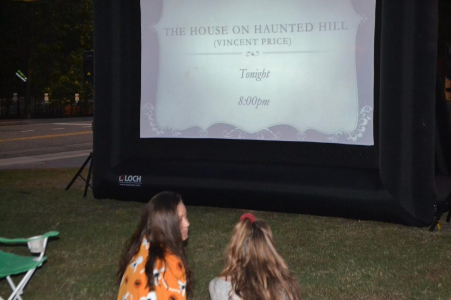"Sophomores, Skylar Chan and Abbey Corley, enjoy Kennesaw's modern ""drive-in"" movie Friday, the 19th at 8 o'clock p.m. ""The movie had a really good vibe and it was something different to do on a Friday night besides a football game,"" Chan said."