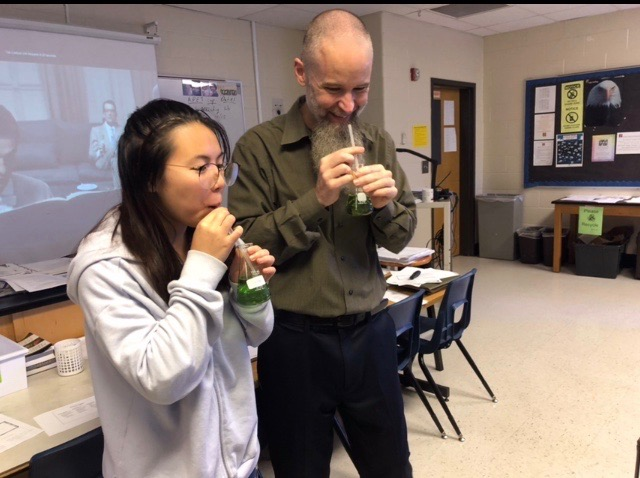 Mr. Evans' AP Environmental Science class learned about ocean acidification through a demo lab. Students discovered how the acidification process worked underwater by blowing carbon dioxide into seawater. The carbon dioxide in their breath  reacted with a chemical in the water and changed its color.