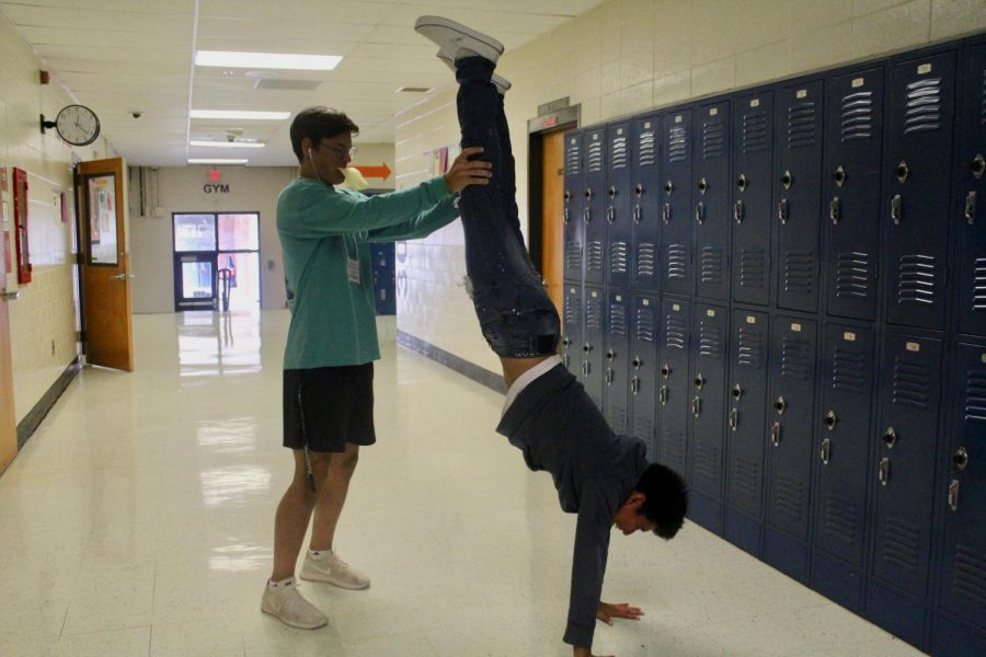 While walking the halls of NC during class, mentorship, newspaper, or—like senior Alex Martinez'—students find all kinds of ways to amuse themselves before heading back to class. On his way to take the government EOC, Martinez relieves his stressful frown by—literally—turning it upside down. Giving himself a boost of confidence and a smile, Martinez walks back to class ready to pour his hand-stand energy into his test.