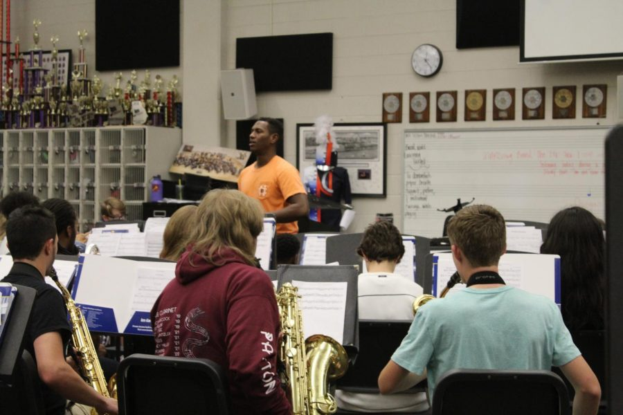 Sheldon+Frazier%2C+one+of+NC%E2%80%99s+band+directors%2C+set+up+a+chapter+of+the+nationwide+program+Tri-M+to+provide+an+opportunity+for+fine+arts+students+from+orchestra%2C+band%2C+and+chorus.+Frazier+teaches+his+symphonic+band+which+contains+a+number+of+students+who+participate+in+Tri-M.
