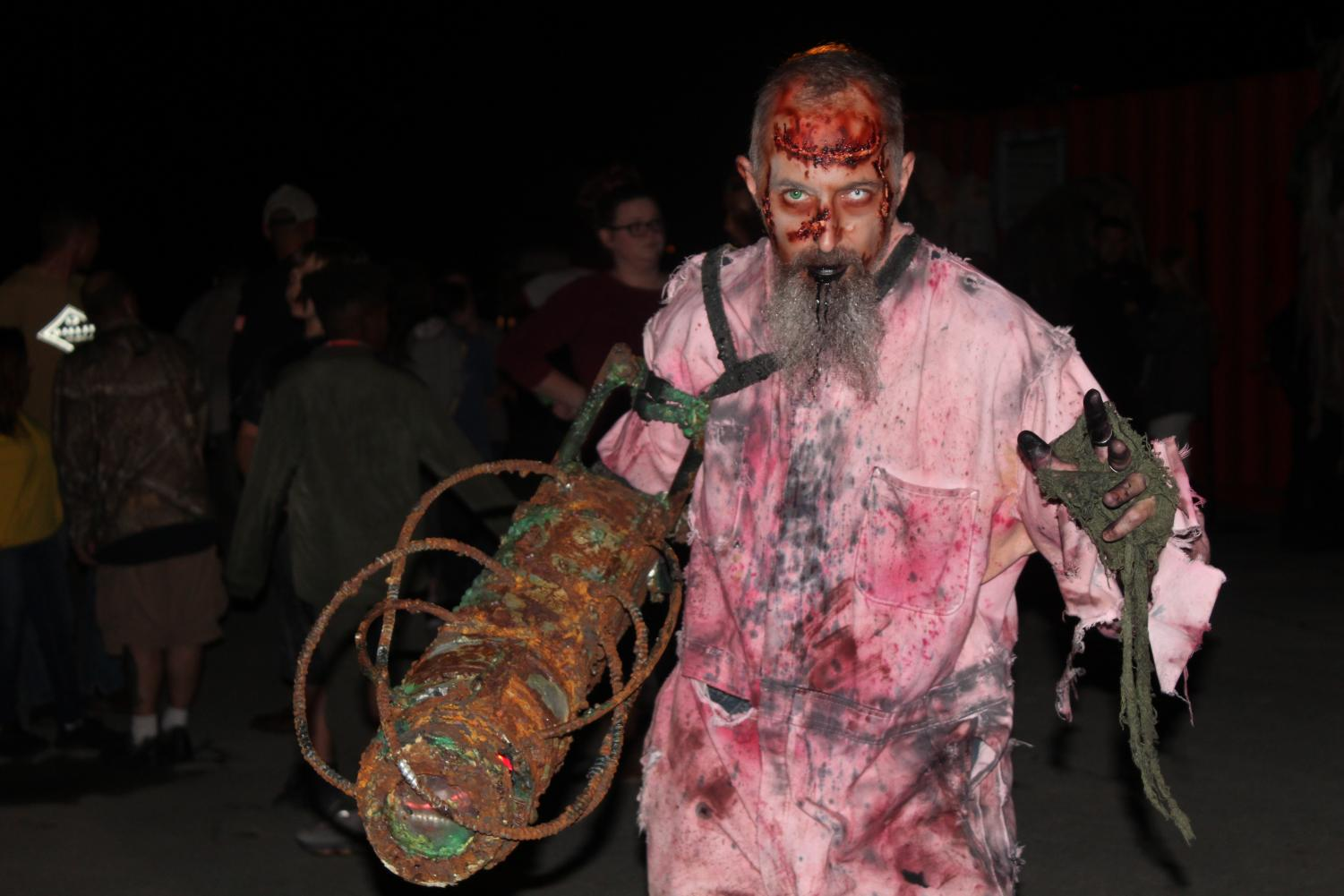 Portraying a deceased patient from a Psych ward, the actor crept around scaring people as they waited in line. From the different color eyes, to the bloody stitching across his face the actor fulfilled his role.