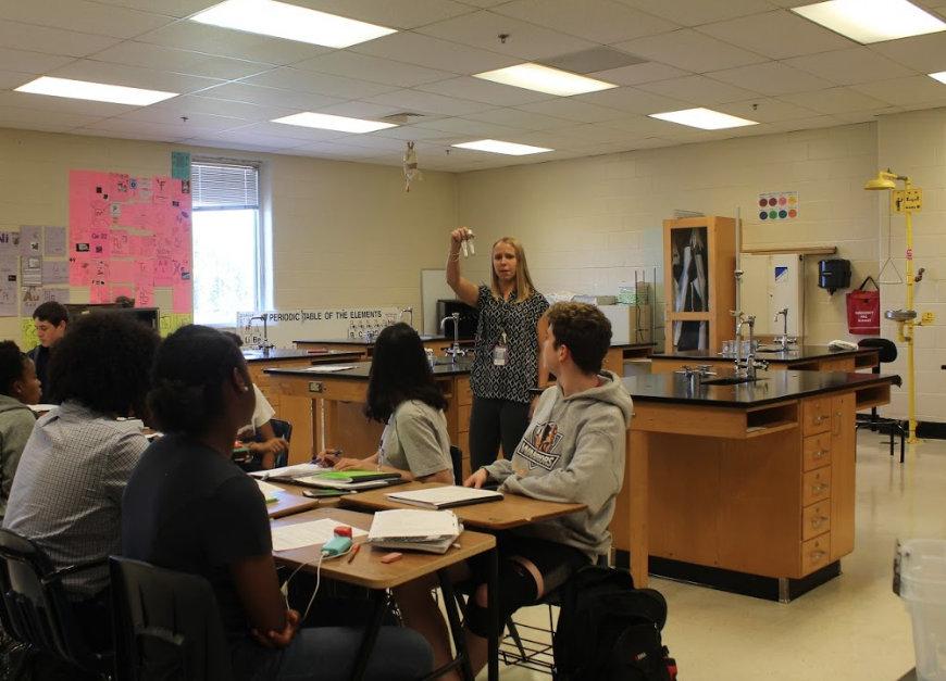 New to NC, Honors Chemistry teacher Rebecca Gregory prepares her students for a lab— her favorite classroom activity. The lab will show her students how to determine if an element has an ionic bond or covalent bond, which students often find difficult to understand.
