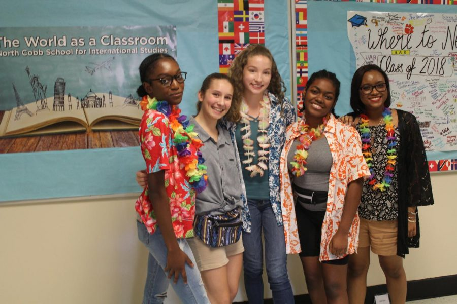 The+sun+shines+brighter+on+this+Monday+morning+as+sophomores+Ella+Day+and+Kaleigh+Everheart%2C+junior+Charly+Hill%2C+and+senior+Leanna+McKenzie+wore+their+fanny+packs%2C+floral+leis%2C+and+vibrant+Hawaiian+shirts+while+posing+like+the+common+tourists+of+the+Bahamas.