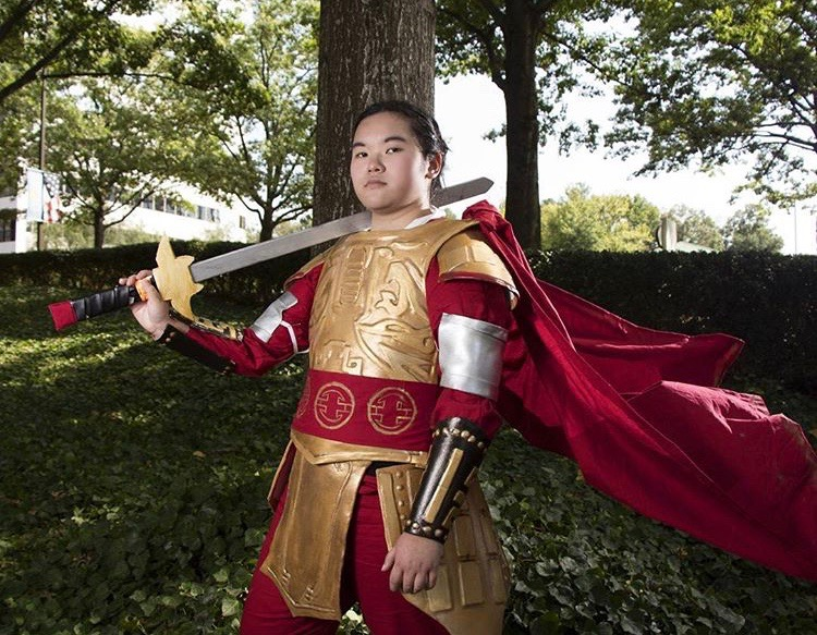 """Livia Eppett cosplays as Disney's warrior Mulan for Anime Weekend Atlanta in 2017. Eppett has participated in cosplays dressed up as a wide variety of characters from animes, movies, and other tv shows. """"I make all my outfits–I gradually have come onto competitions because of them,"""" Livia said."""