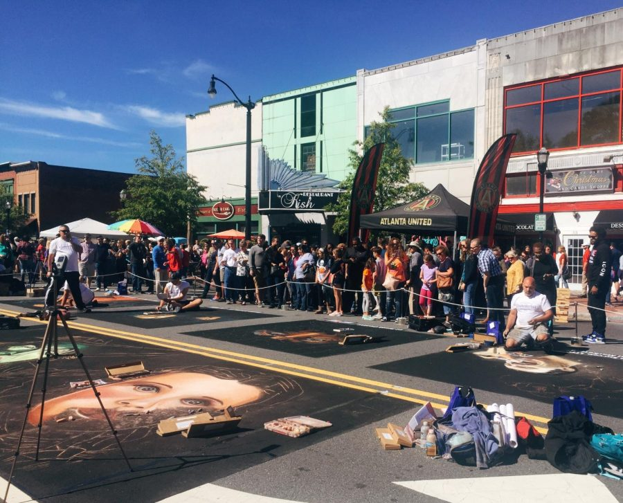 Crowds of people paraded around the different artists as they created large, colorful artwork out of only chalk, paint brushes, and their hands. From landscapes to vivid faces, each art piece showed incredible skill and artistry.