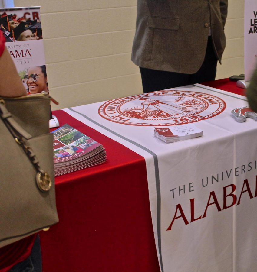 University of Alabama representative Andrew Morrison eagerly waits for parents and students to approach him with questions about the school.