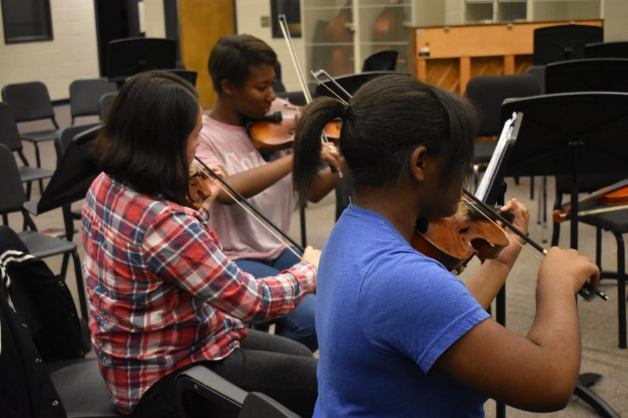 These four orchestra violinists give up their lunch time to practice for the upcoming Tree Lighting Ceremony. The students hope to master their Christmas music pieces before performing on Thursday, November 29 at 5:30 p.m. at the Wellstar Acworth Health Park.