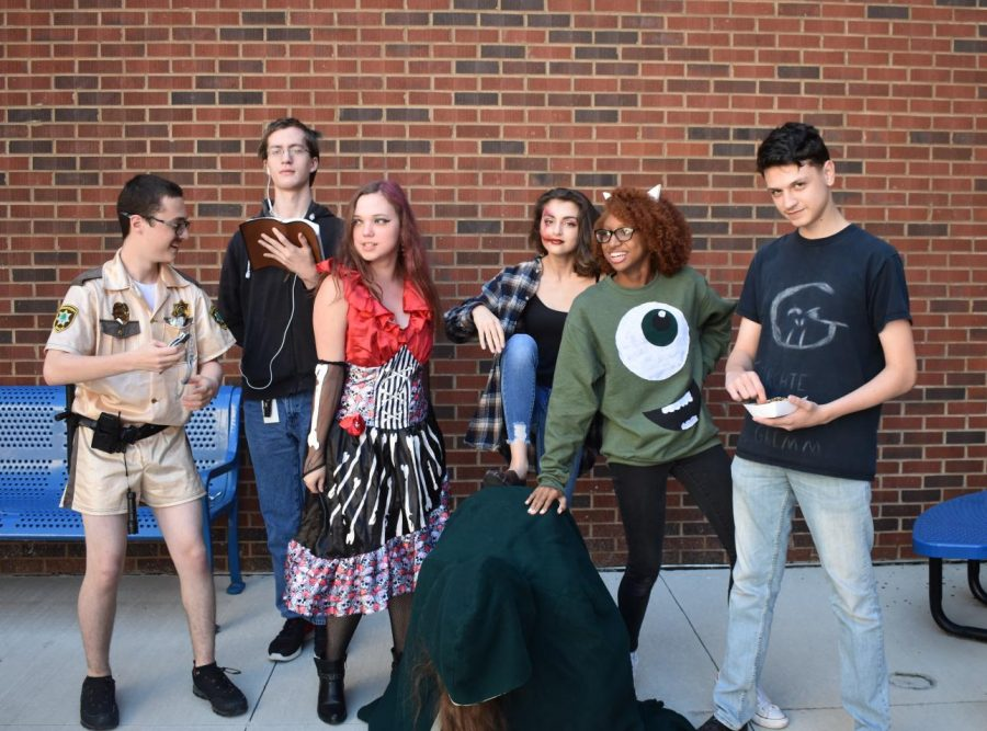"""Students dressed up in their Halloween costumes today to celebrate the holiday. Most of these costumes consisted of fictional characters or occupational extremes, including a gay priest purposefully trying to make a statement. """"I think that senior year is scarier than Halloween,"""" senior Katherine Benedict said."""