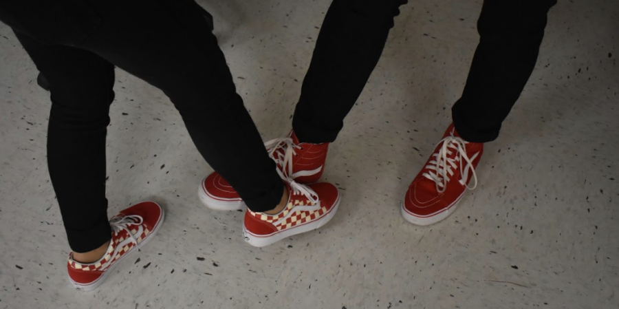Marking the second day of Red Ribbon Week, students arrived to school decked out in their red clothing. Sophomores Naoshin Kaiser and Drew Dodd struck a fun pose in their red Vans. The rest of the dress up days for this week include Crazy Hair Day, Twin Day, and Sports/Career Day.
