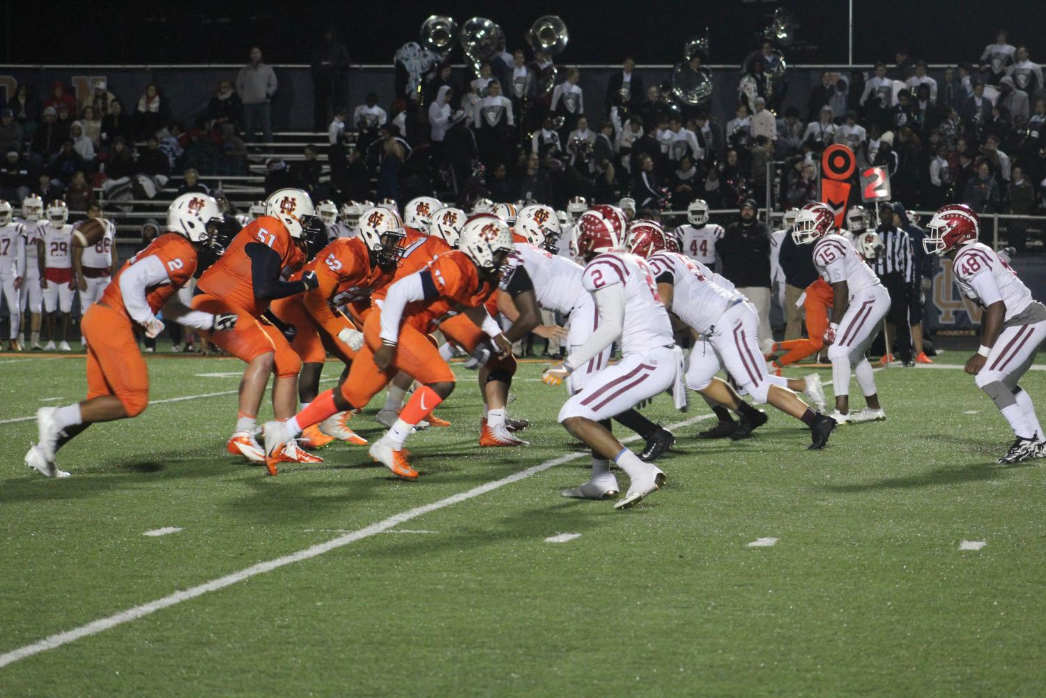 """The NC Varsity football team played their last game of the season against the undefeated team from Hillgrove. NC's defense prepared to stop Hillgrove from making a first down. """"The outcome of the game was a good one because the players left everything they had out on the field,"""" Coach Donte Sawyer said."""