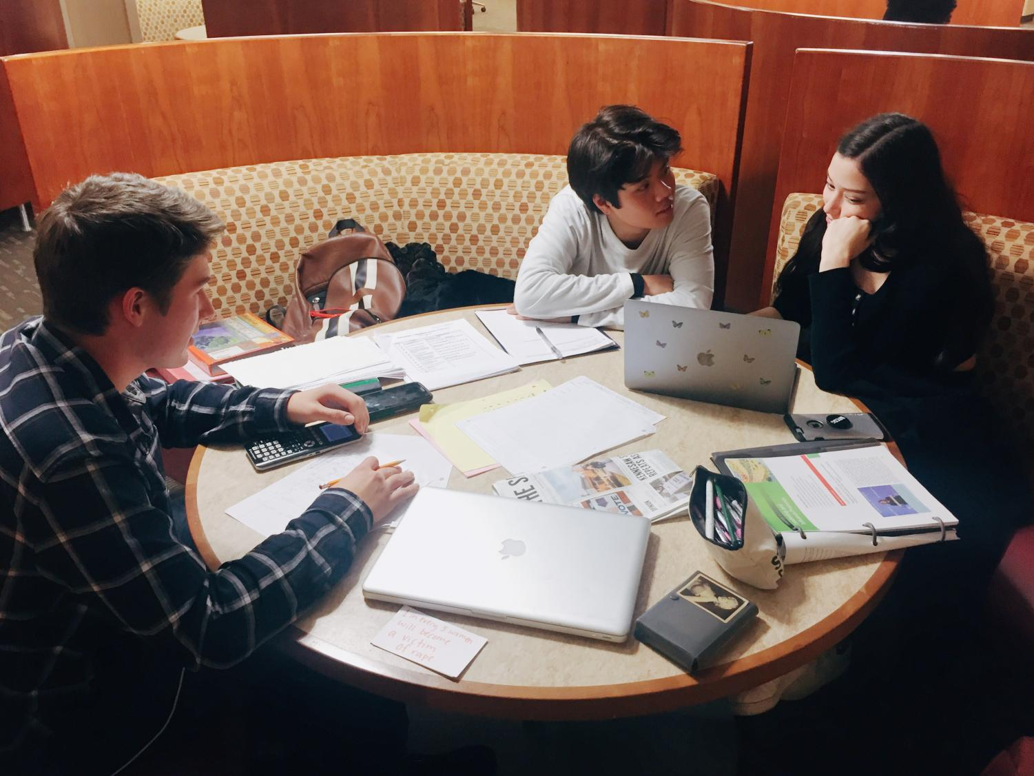 NC seniors Reed Walker, Ryan Camesa, and Christine Call utilize the community's public facilities to study for their upcoming finals and complete homework.