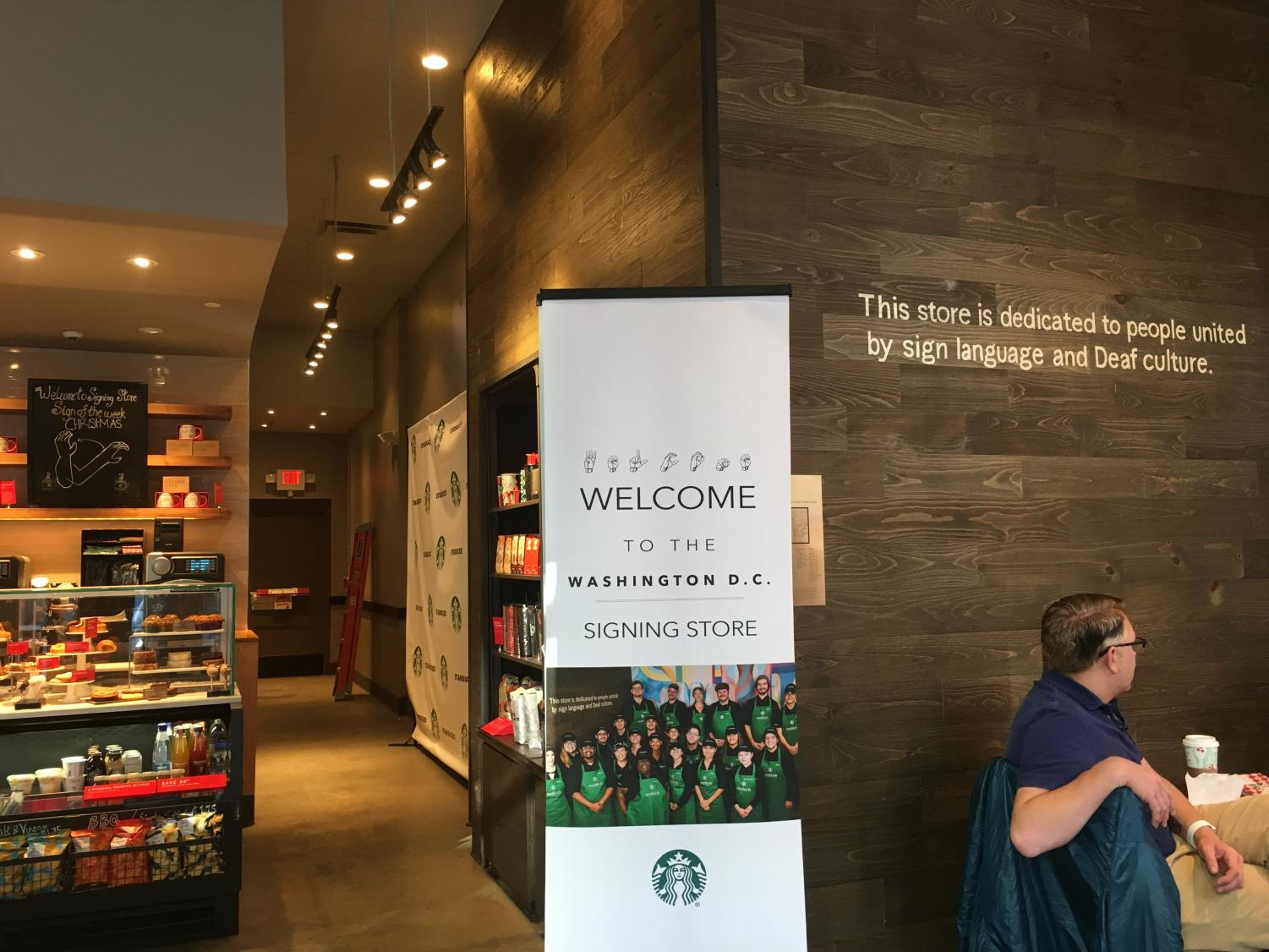 """The storefront of the Starbucks displays the name of the store in ASL. This gives a unique visual to catch people's eyes as they walk down the street. """"The Starbucks puts hearing people in deaf people's shoes,"""" sophomore Devlin said."""
