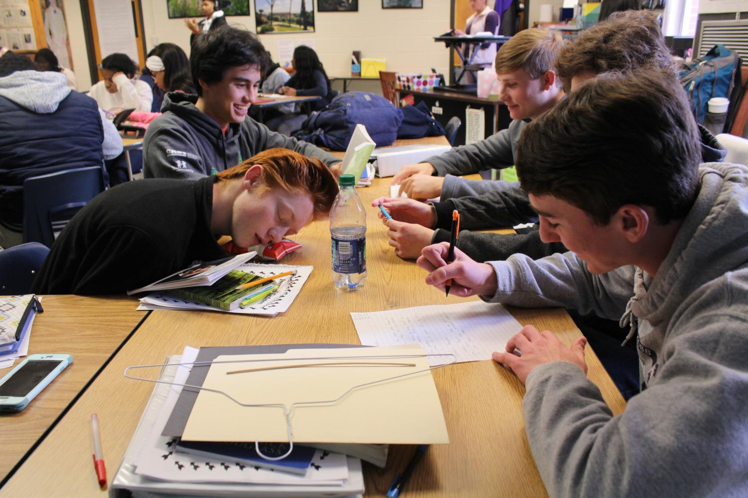 """Confusion and excitement sent Mrs. Lawson's Honors American Lit class abuzz as she gave students a project to complete—except with a twist—no clear instructions, an abstract objective, and complete silence when students asked her confused questions. Students received a manila folder of supplies to construct the purpose of the project. """"We picked up a manila folder with a coat hanger, string, a stick, an index card, black construction paper, and a notecard. All we know is that we have to relate the project back to the unit: Individuals Taking a Stand,"""" junior Aiden Minard said. Though abstract in concept, the project pushed students past their creative boundaries. """"This project delves into our creativity by making us think more creatively and to better understand the theme of this unit,"""" junior Patrick Moran said."""